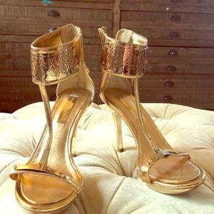 BCBG MAX AZRIA Metallic Phoenix T Strap Sandals